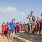 intrepid travel tanzania cycling mkuru travellers jumping with masai small