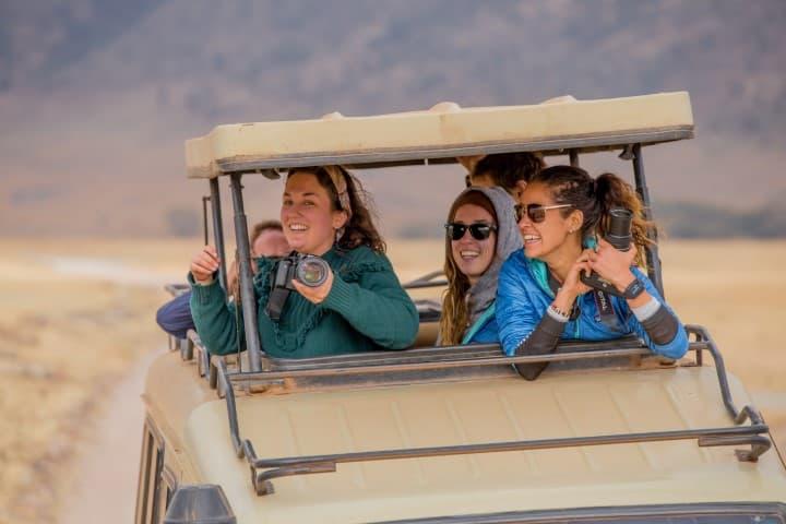 intrepid travel tanzania ngorongoro safari 4wd traveller with cameras small